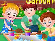 Малятко Хейзел копається в саду